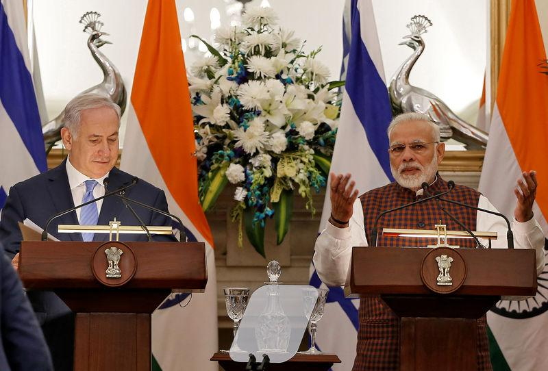 India's Prime Minister Modi speaks as his Israeli counterpart Netanyahu looks on during a signing of agreements ceremony at Hyderabad House in New Delhi
