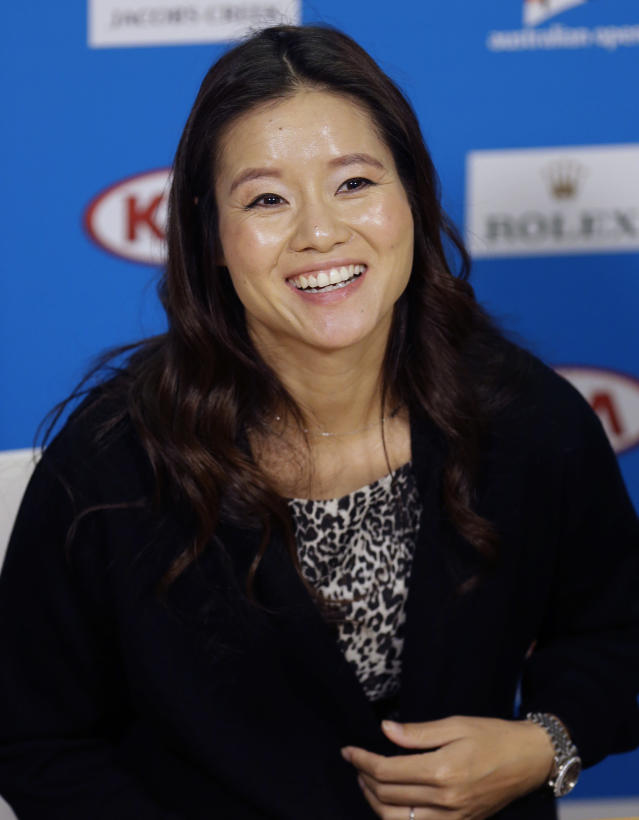 FILE- In this Jan. 20, 2015, file photo retired tennis championship Li Na of China, speaks at the Australian Open tennis championship in Melbourne, Australia. Li Na is the first player from Asia elected to the International Tennis Hall of Fame. She joins Mary Pierce and Yevgeny Kafelnikov in the Class of 2019, which was announced Monday, Jan. 21, 2019, at the Australian Open. (AP Photo/Mark Baker, File)
