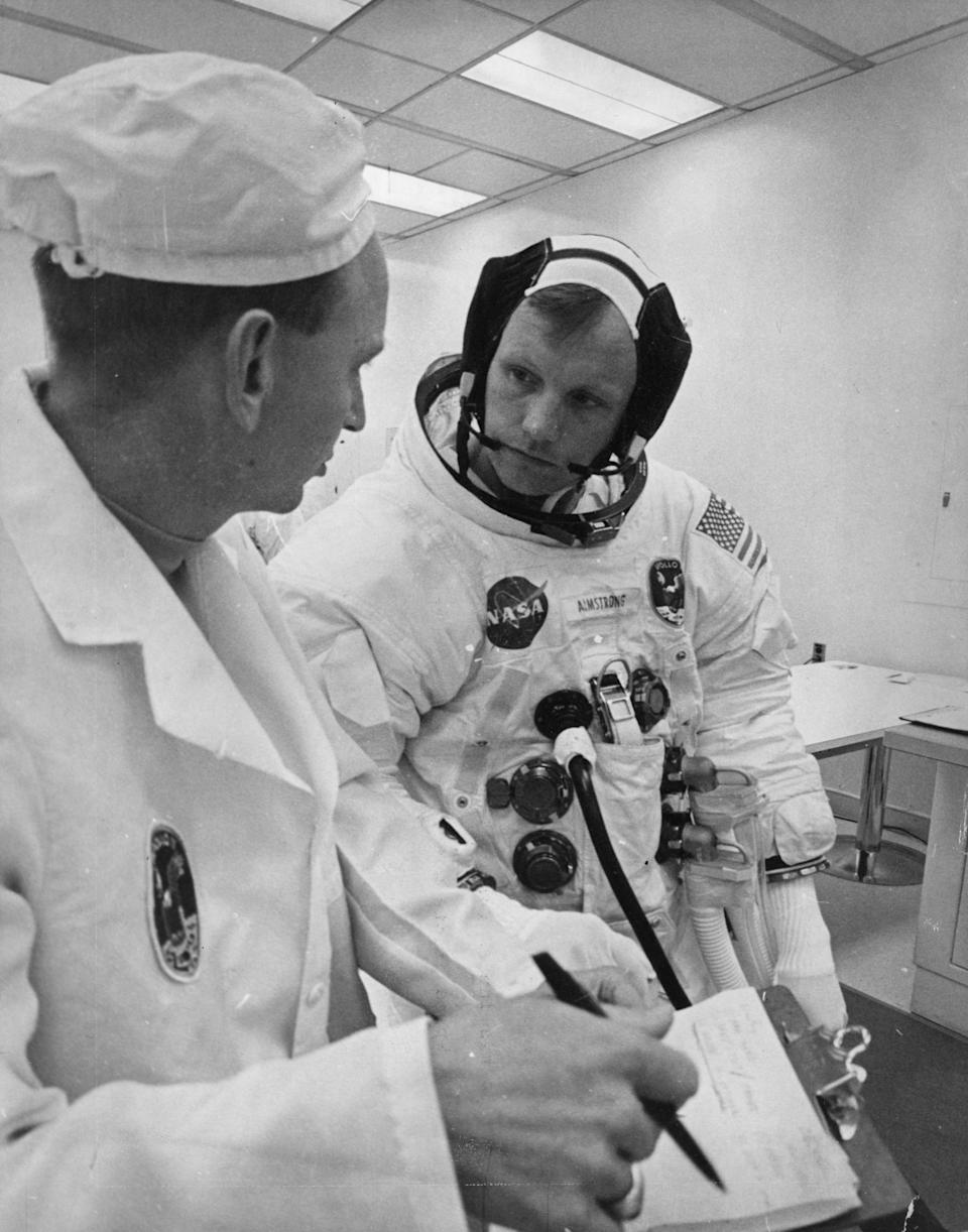Apollo 11 commander Neil Armstrong runs through final notes before the launch of the Apollo/Saturn V space vehicle at the Kennedy Space Centre, Florida on July 16, 1969.  (Photo by NASA/Keystone/Getty Images)