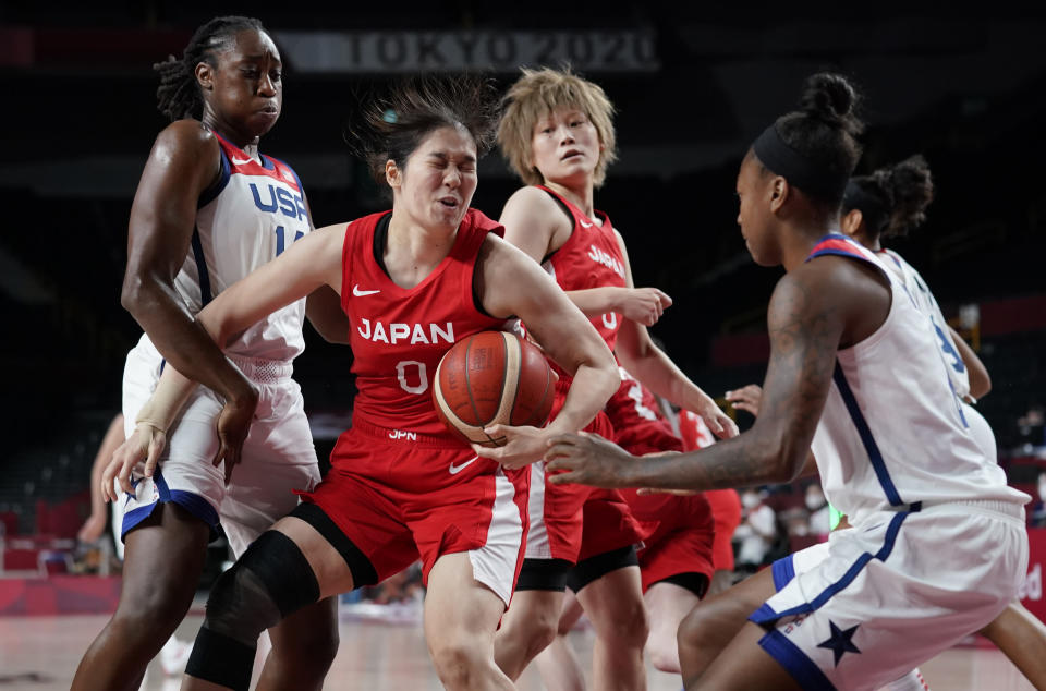 Japan's Moeko Nagaoka (0), second left, drives past United States' Tina Charles (14), left, during women's basketball preliminary round game at the 2020 Summer Olympics, Friday, July 30, 2021, in Saitama, Japan. (AP Photo/Charlie Neibergall)