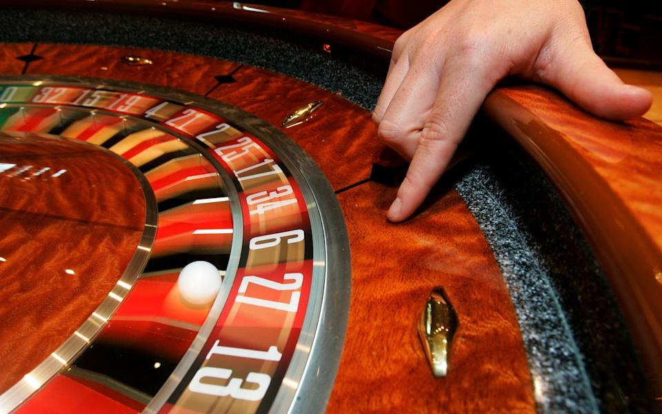 File photo of a croupier with a roulette table - Andrew Milligan/PA Wire