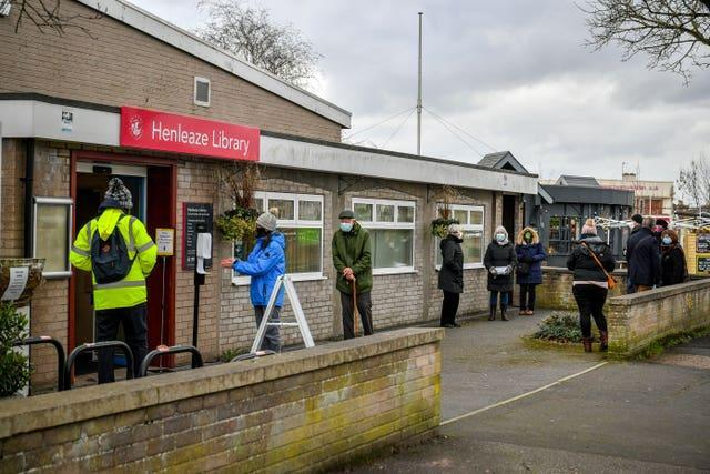 People wait in a queue for a coronavirus test at a surge test centre (Ben Birchall/PA)