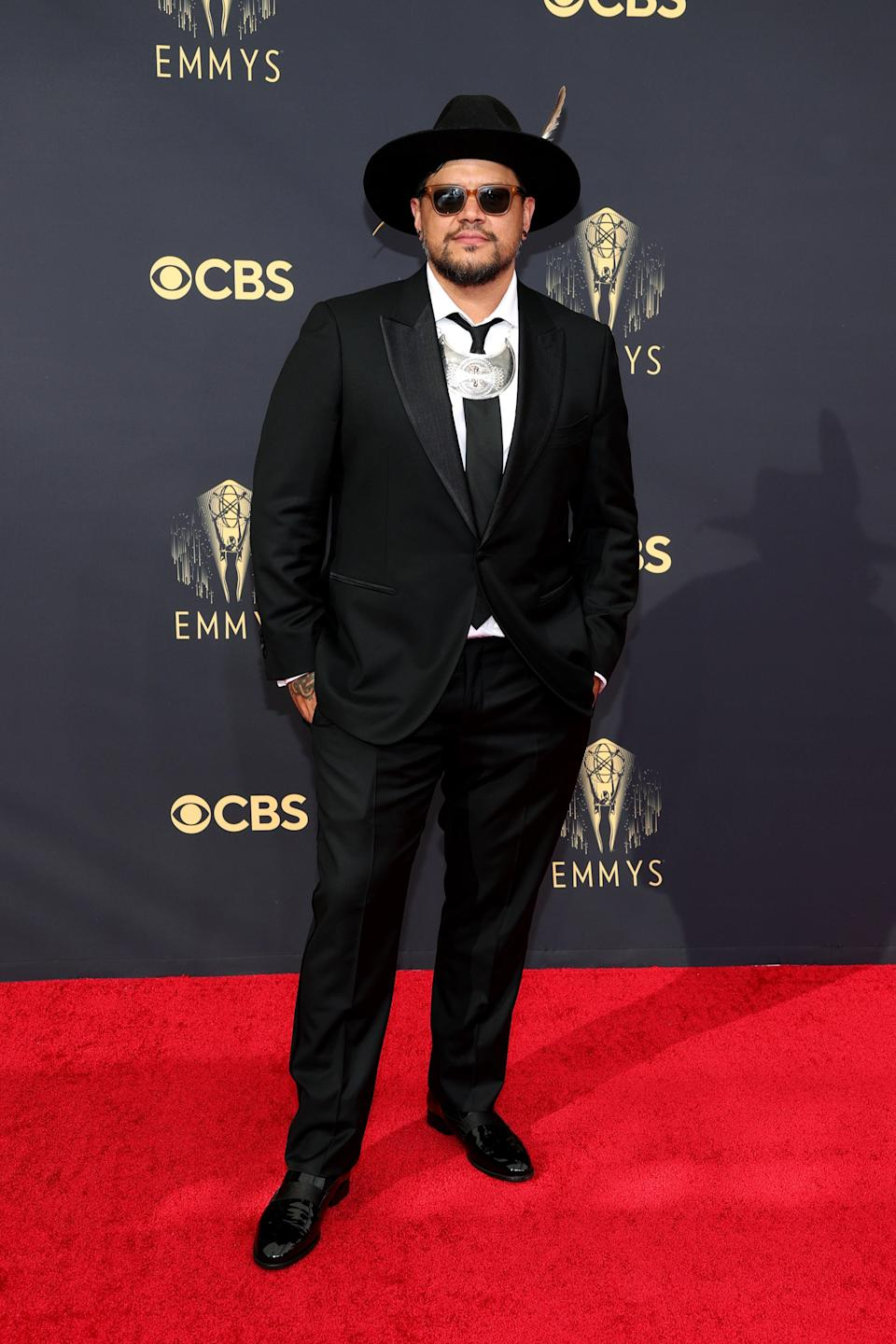 It was all about accessories for filmmaker Sterlin Harjo, who wore sunglasses, a hat, and a silver necklace with his black tux.