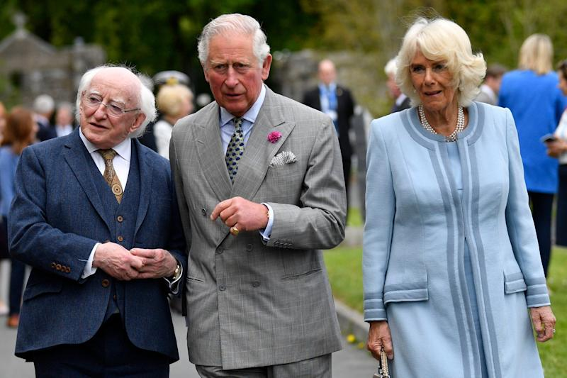 The Prince of Wales and the Duchess of Cornwall, accompanied by the President of Ireland during a visit to Glencree Peace and Reconciliation Centre (PA)