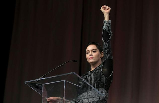 Rose McGowan raises her fist during her opening remarks to the audience at the Women's Convention in Detroit, Oct. 27, 2017. (Photo: Rena Laverty/AFP/Getty Images)