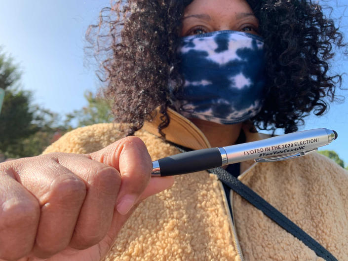 """Sadiyyah Porter-Lowdry shows off her 'I voted in the 2020 election' after voting Tuesday, Nov. 3, 2020 in Charlotte, N.C. """"A lot of people were fearful to come out and vote today and for me I didn't want fear to stop me from voting on Election Day,"""" she said. (AP Photo/Sarah Blake Morgan)"""
