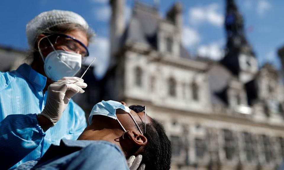 A health worker prepares to administer a swab test in Paris.