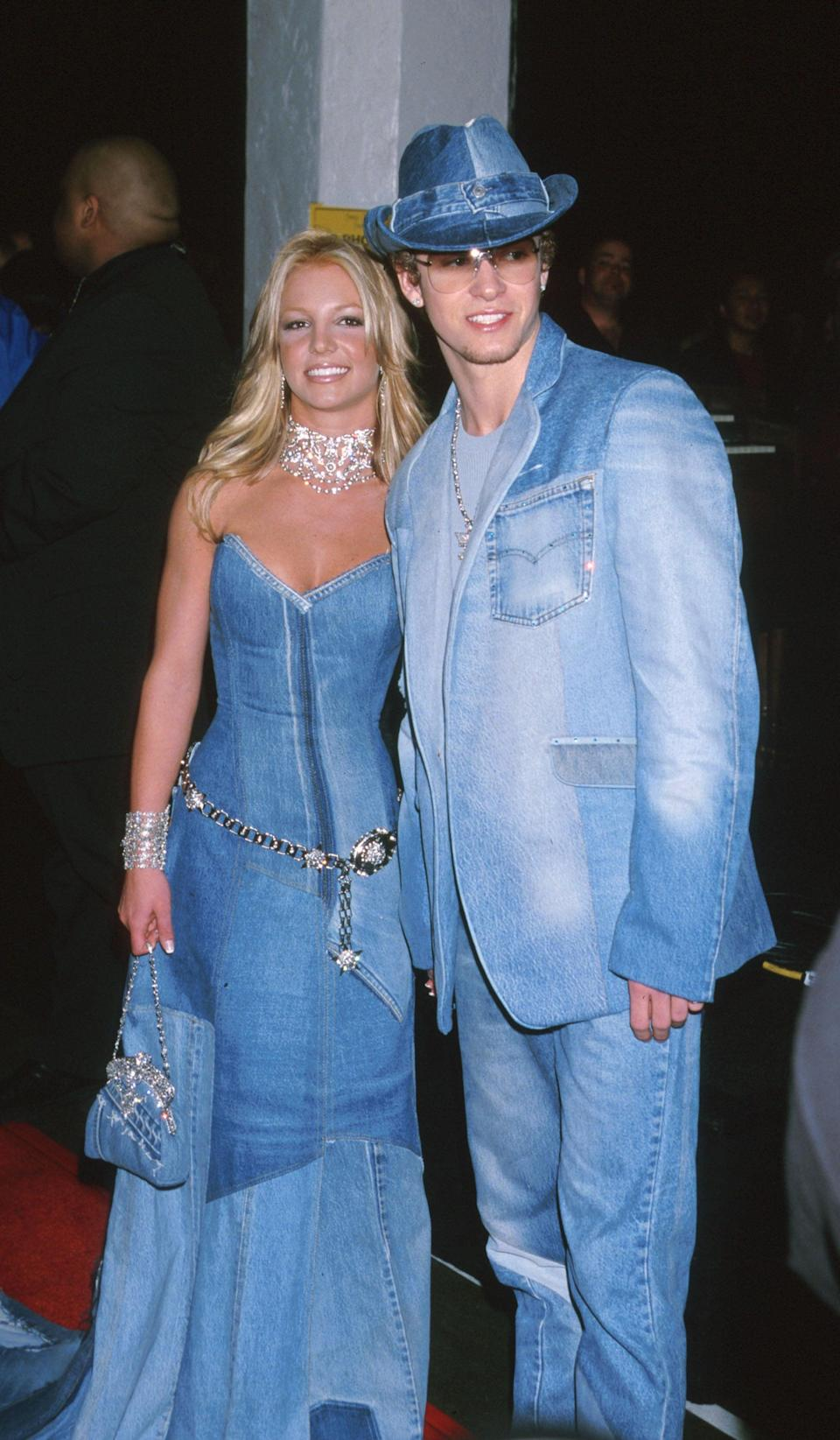 """<p>At the 2001 American Music Awards wearing matching denim outfits with <a class=""""link rapid-noclick-resp"""" href=""""https://www.popsugar.com/Justin-Timberlake"""" rel=""""nofollow noopener"""" target=""""_blank"""" data-ylk=""""slk:Justin Timberlake"""">Justin Timberlake</a>. </p>"""