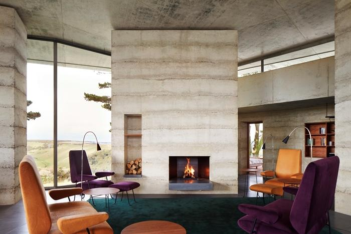 The main living space uses stone and concrete and has underfloor heating (Picture: Jack Hobhouse)