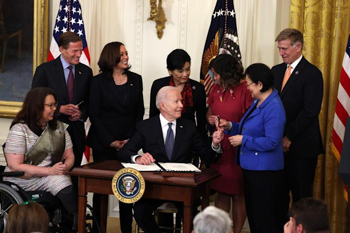 President Joe Biden hands a pen to Sen. Mazie Hirono, D-Hawaii, after signing the COVID-19 Hate Crimes Act into law May 20. Joining them at the White House for the signing are, from left, Sen. Tammy Duckworth, D-Ill.; Sen. Richard Blumenthal, D-Conn.; Vice President Kamala Harris; Rep. Judy Chu, D-Calif.; Rep. Grace Meng, D-N.Y.; and Rep. Don Beyer, D-Va.The legislation, drafted in response to violence against the Asian American and Pacific Islander (AAPI) community during the coronavirus pandemic, will create a position in the Department of Justice to focus on the rise in hate crimes and provide resources to federal, state and local jurisdictions to better report cases.