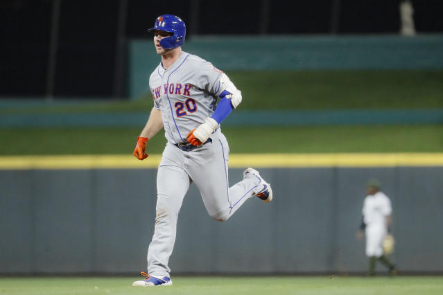 New York Mets' Pete Alonso runs the bases after hitting a two-run home run off Cincinnati Reds starting pitcher Sal Romano in the eighth inning of a baseball game, Friday, Sept. 20, 2019, in Cincinnati. (AP Photo/John Minchillo)