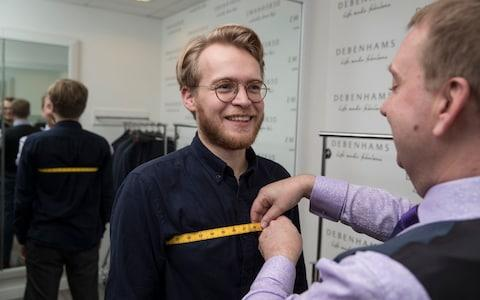 Tom Ough being measured up for a bespoke suit at Debenhams by Peter - Credit: Heathcliff O'Malley