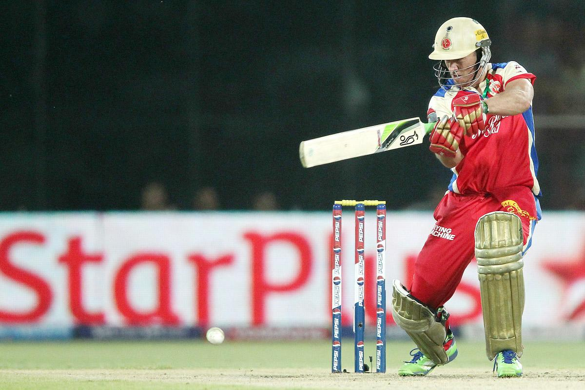AB de Villiers of the Royal Challengers Bangalore square cuts a delivery during match 57 of the Pepsi Indian Premier League between Delhi Daredevils and the Royal Challengers Bangalore held at the Feroz Shah Kotla Stadium, Delhi on the 10th May 2013.(BCCI)