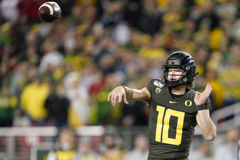 Oregon quarterback Justin Herbert (10) was picked by the Los Angeles Chargers. (AP Photo/Tony Avelar)
