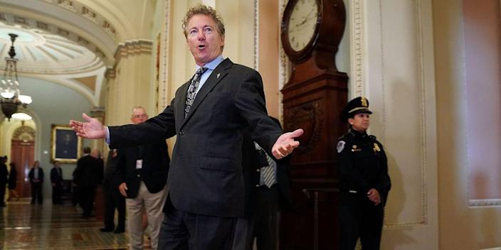 Sen. Rand Paul (R-KY) gestures toward reporters following the weekly Republican policy luncheon at the U.S. Capitol October 24, 2017 in Washington, DC.