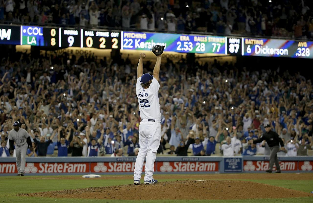 Los Angeles Dodgers starting pitcher Clayton Kershaw celebrates his no-hitter against the Colorado Rockies after the last out of a baseball game in Los Angeles, Wednesday, June 18, 2014. Kershaw struck out a career-high 15 batters. (AP Photo/Chris Carlson)