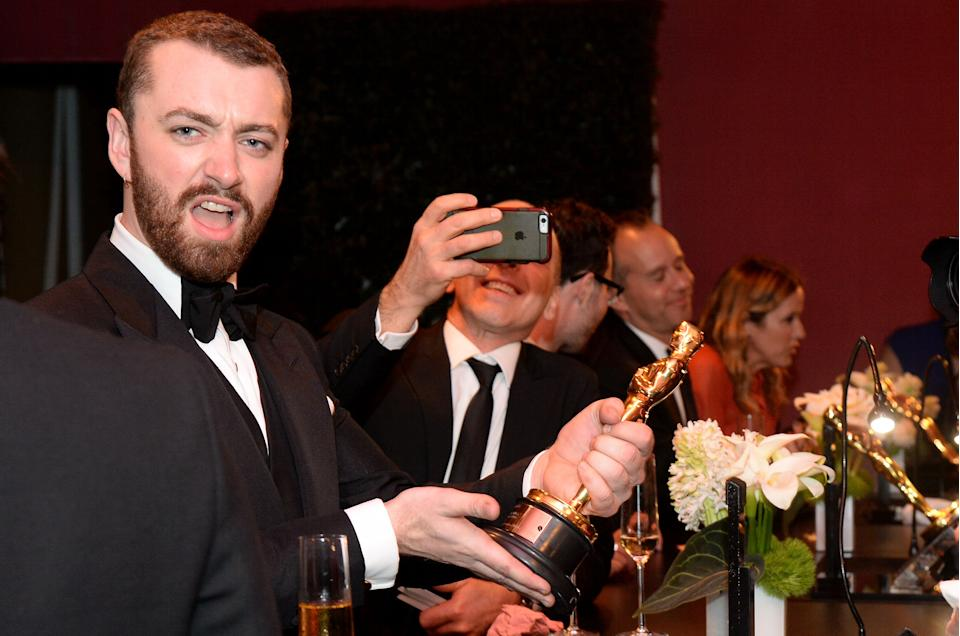 Singer-songwriter Sam Smith, winner of the Best Original Song award for 'Writing's on the Wall' from 'Spectre,' poses at the 88th Annual Academy Awards Governors Ball at Hollywood & Highland Center in  Hollywood, California, on February 28, 2016.  / AFP / ANGELA WEISS        (Photo credit should read ANGELA WEISS/AFP/Getty Images)