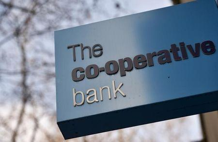 A sign hangs outside of a branch of The Co-operative Bank in London