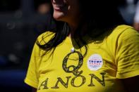 A supporter of U.S. President Donald Trump wears a QAnon shirt after participating in a caravan convoy circuit in Adairsville
