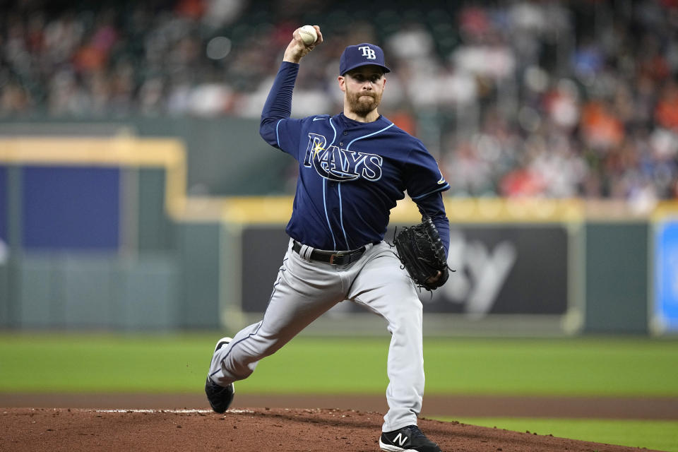 Tampa Bay Rays starting pitcher Collin McHugh throws against the Houston Astros during the first inning of a baseball game Thursday, Sept. 30, 2021, in Houston. (AP Photo/David J. Phillip)