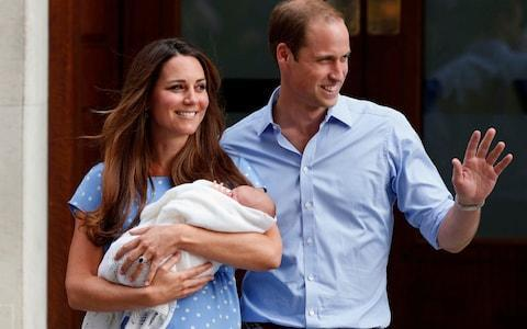 Prince William and Kate, Duchess of Cambridge, hold their new born son George - Credit: Lefteris Pitarakis