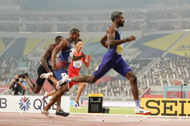 Noah Lyles, right, of the United States, wins the men's 200 meters at the World Athletics Championships in Doha, Qatar, Tuesday, Oct. 1, 2019. (AP Photo/David J. Phillip)