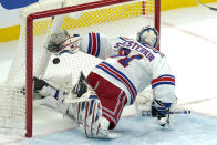 New York Rangers goaltender Igor Shesterkin watches the puck go past him for a goal by Boston Bruins left wing Jake DeBrusk (74) in the second period of an NHL hockey game, Thursday, May 6, 2021, in Boston. (AP Photo/Elise Amendola)