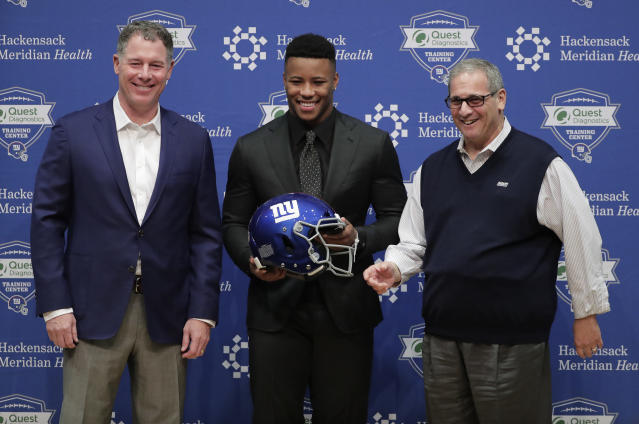 New York Giants first round NFL football draft pick running back Saquon Barkley, center, poses for photos with Giants head coach Pat Shurmur, left, and general manager Dave Gentleman during a news conference, Saturday, April 28, 2018, in East Rutherford, N.J. Barkley was selected as the number two overall pick in the NFL football draft by the New York Giants. (AP Photo/Julie Jacobson)