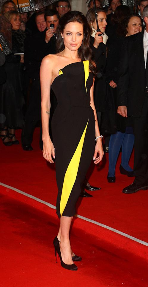 13. British Academy of Film and Television Arts Awards (2009)   Angie was back in black (and yellow) at the 62nd BAFTAs in a fabulous Armani Prive Spring 2009 frock, which featured a folded bodice and an interesting, mid-calf length.