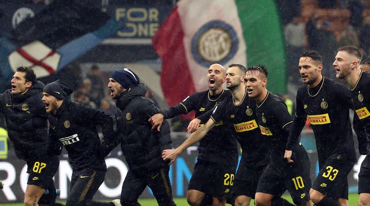 Inter's players celebrate the victory at the end of the Italian serie A soccer match between Inter and Spal at the Giuseppe Meazza stadium in Milan, Italy. (AP Photo)
