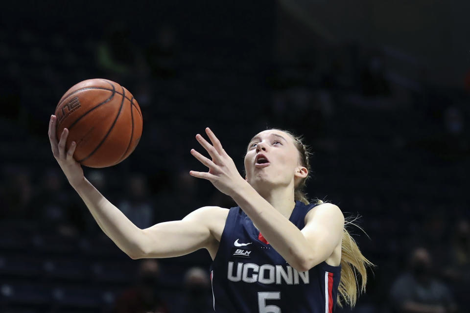 FILE - UConn guard Paige Bueckers (5) shoots against Xavier during the first half of an NCAA college basketball game in Cincinnati, in this Saturday, Feb. 20, 2021, file photo. UConn's star guard became the first freshman ever to win The Associated Press women's basketball player of the year award on Wednesday, March 31, 2021. (AP Photo/Gary Landers, File)