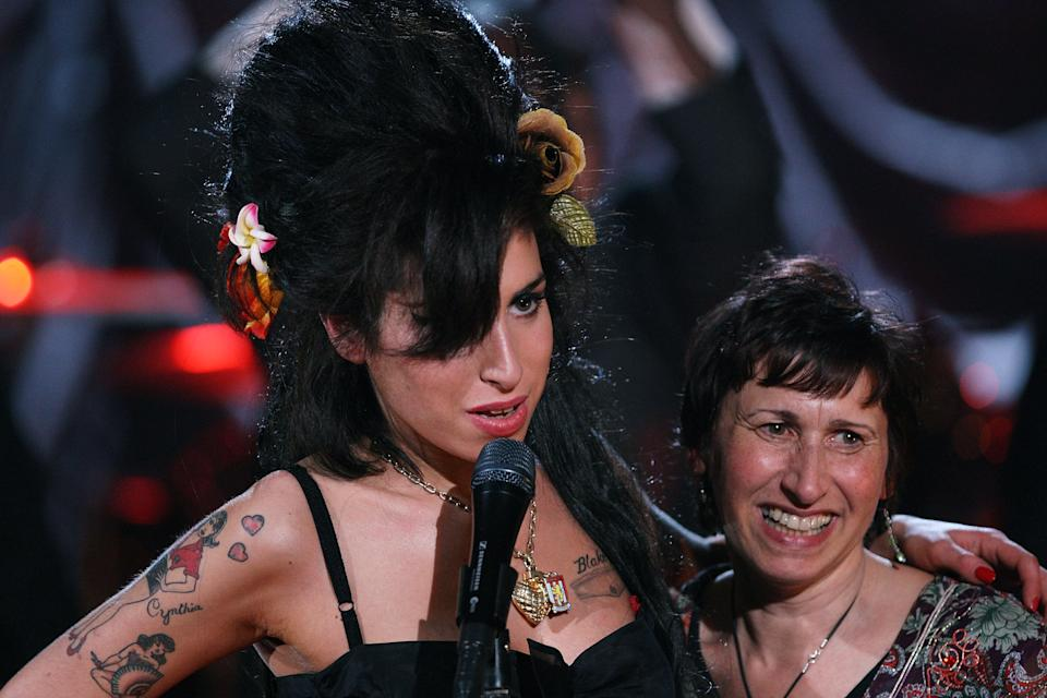 Amy Winehouse (L) hugs her mother Janis Winehouse after accepting a Grammy Award at the Riverside Studios for the 50th Grammy Awards ceremony via video link on February 10, 2008 in London, England. (Photo by Peter Macdiarmid/Getty Images for NARAS)