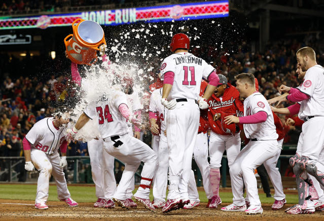 <p>Washington Nationals' Bryce Harper (34) is doused as he scores on his game-winning two-run homer during the ninth inning of a baseball game against the Philadelphia Phillies at Nationals Park on May 13, 2017, in Washington. The Nationals won 6-4. (Photo: Alex Brandon/AP) </p>
