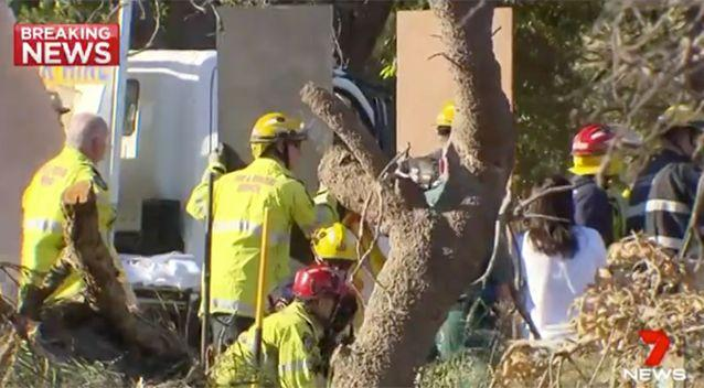 Boards were  used to buttress the trench. Source: 7 News