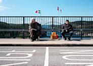 Identical twins Pontus (L) and Ola Berglund have met up on a bridge every Saturday, each keeping to their own side of the Norwegian-Swedish border