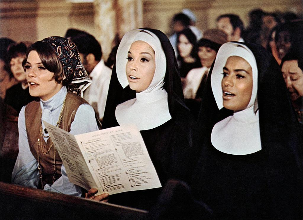 <p>Moore played Sister Michelle, a nun in street clothes, opposite Elvis Presley in his final dramatic role, as a good doctor in a bad neighborhood. This 1969 box-office dud hardly marked Moore's high point on the big screen, but it makes for a fascinating watch. <br />(Credit: Everett Collection) </p>