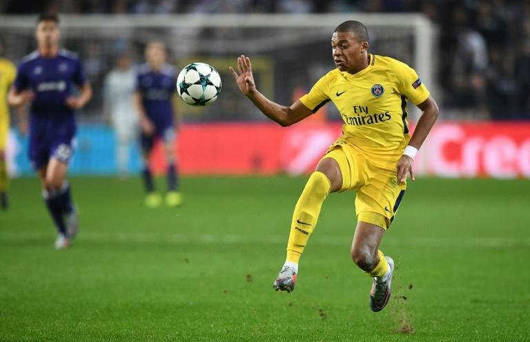 Paris Saint-Germain's Kylian Mbappe plays the ball during their UEFA Champions League match against RSC Anderlecht in Brussels on October 18, 2017