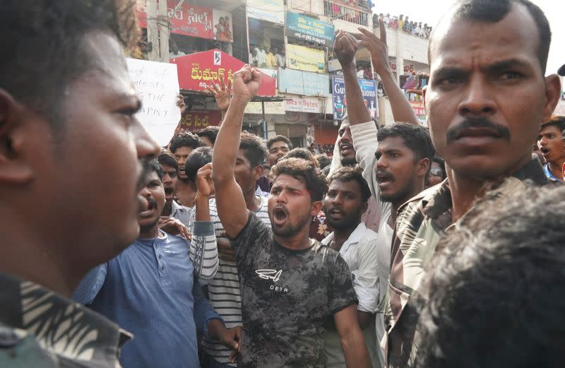 People shout slogans during a protest against the alleged rape and murder of a 27-year-old woman in Shadnagar