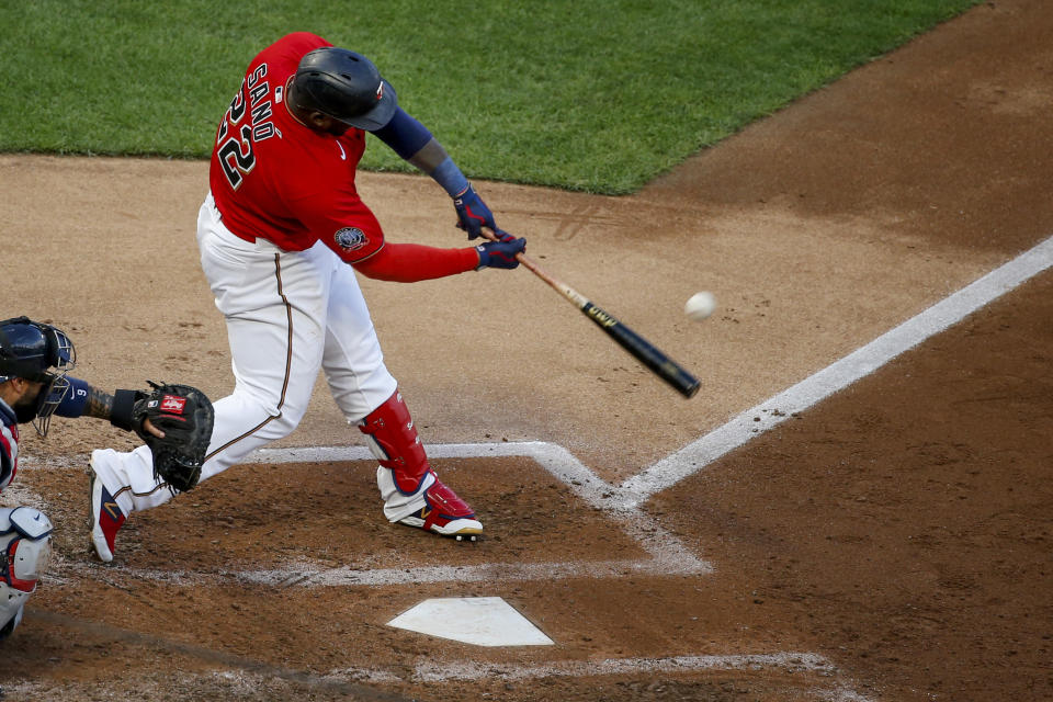 Minnesota Twins' Miguel Sano hits a solo home run against the Cleveland Indians during the fifth inning of a baseball game Saturday, Aug. 1, 2020, in Minneapolis, his second solo homer of the night. (AP Photo/Bruce Kluckhohn)