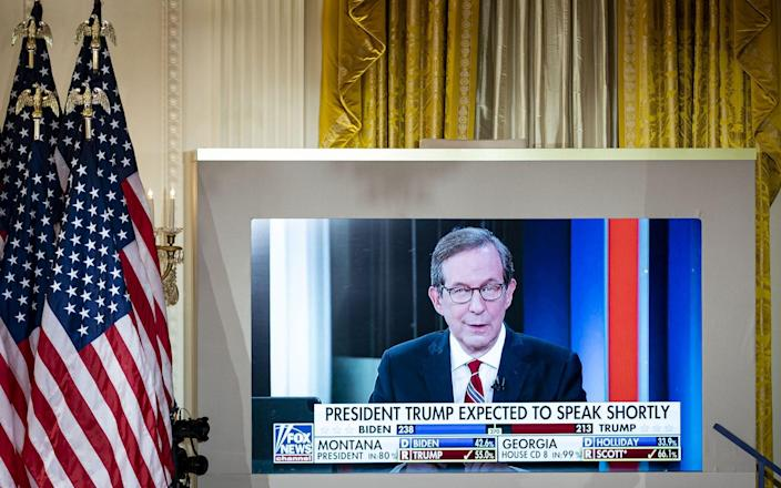 A TV in the White House shows Fox News coverage on election night - Al Drago/ Bloomberg