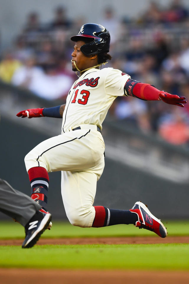 Atlanta Braves' Ronald Acuna Jr. leaps into a dive to second base before being tagged out attempting a double on a line drive to center field during the second inning of a baseball game against the Washington Nationals, Sunday, July 21, 2019, in Atlanta. (AP Photo/John Amis)
