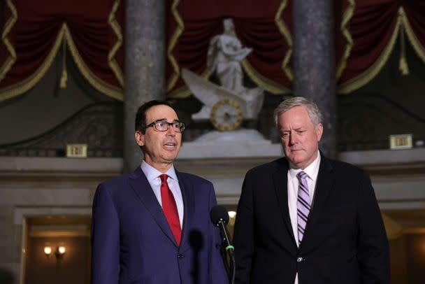 PHOTO: White House Chief of Staff Mark Meadows and Secretary of the Treasury Steven Mnuchin speak to members of the press after a meeting at the office of Speaker of the House Rep. Nancy Pelosi at the U.S. Capitol, Aug. 7, 2020 in Washington, DC. (Alex Wong/Getty Images)