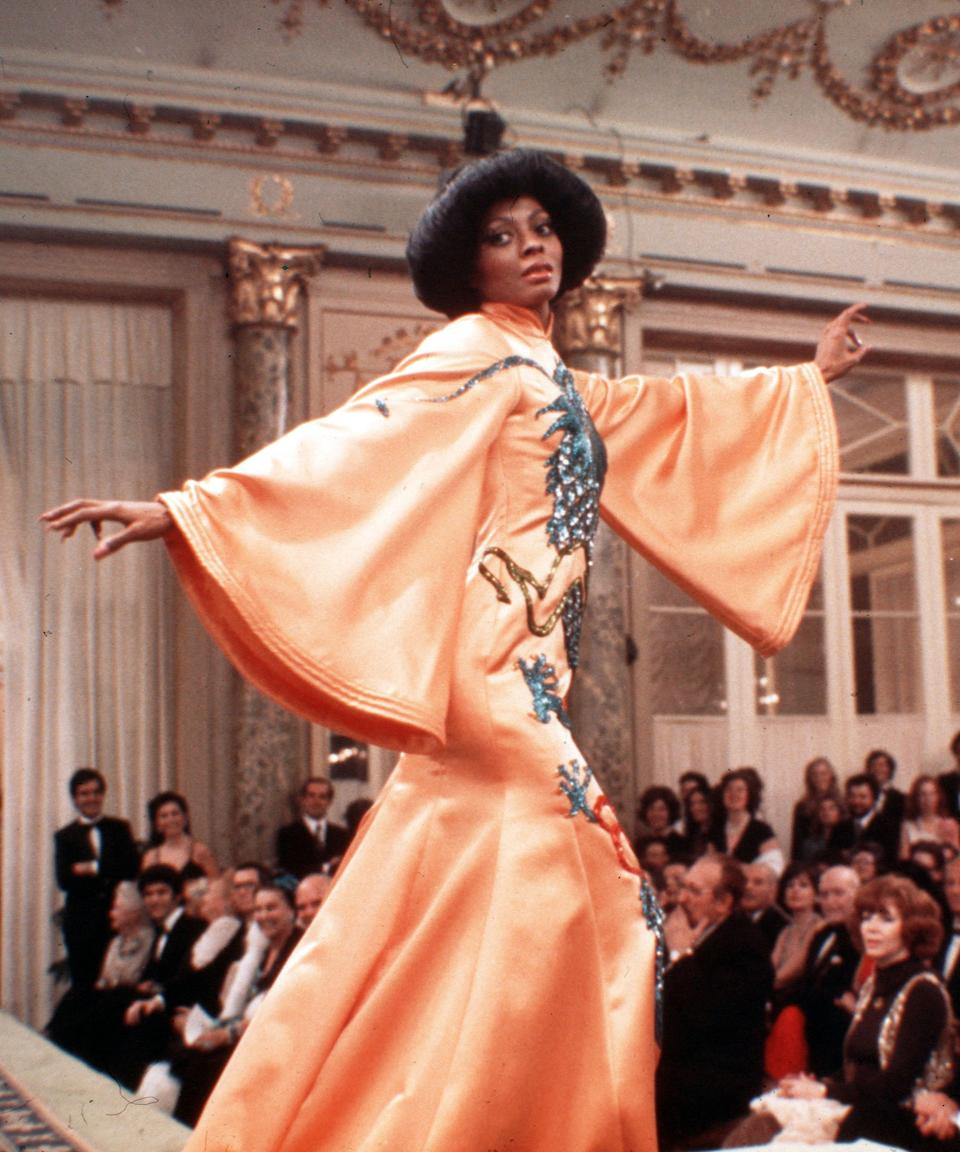 """<em><h2>Mahogony (1975)</h2></em><br>The story of a fashion design student, played by the one-and-only Diana Ross, struggling to succeed in Chicago, <em>Mahogony</em> is everything that we always pictured a career in fashion to look like: glamorous, yet extremely demanding. The costumes, designed by Ross herself, are equally as impressive, from the rainbow frock she can be seen twirling around her aunt's garment factory in to the brown beaded gown she wears while taking a final bow after presenting her collection. <span class=""""copyright"""">Photo: Paramount/Kobal/Shutterstock.</span>"""