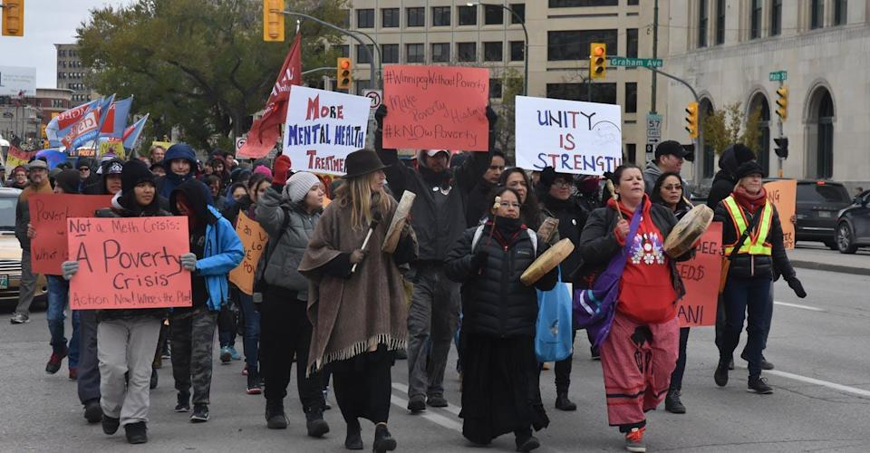 """<span class=""""caption"""">Anti-poverty protesters march in downtown Winnipeg in 2018.</span> <span class=""""attribution""""><span class=""""source"""">Andrew Tod/Manitoba Federation of Labour</span>, <span class=""""license"""">Author provided</span></span>"""