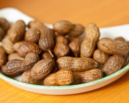 """<p>Boiled peanuts are one of the <a href=""""https://www.thedailymeal.com/recipe/game-day-recipes-football?referrer=yahoo&category=beauty_food&include_utm=1&utm_medium=referral&utm_source=yahoo&utm_campaign=feed"""" rel=""""nofollow noopener"""" target=""""_blank"""" data-ylk=""""slk:must-have game day snacks"""" class=""""link rapid-noclick-resp"""">must-have game day snacks</a> in the South. This Southern appetizer consists of peanuts that have been boiled until they reach a soft consistency. They are then seasoned with ground chile and seasoned salt.</p> <p><a href=""""https://www.thedailymeal.com/boiled-peanuts-recipe?referrer=yahoo&category=beauty_food&include_utm=1&utm_medium=referral&utm_source=yahoo&utm_campaign=feed"""" rel=""""nofollow noopener"""" target=""""_blank"""" data-ylk=""""slk:For the Boiled Peanuts recipe, click here."""" class=""""link rapid-noclick-resp"""">For the Boiled Peanuts recipe, click here.</a></p>"""