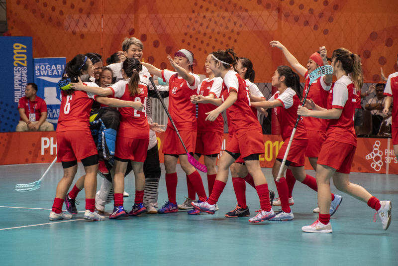The Singapore women's floorball team celebrate their 3-2 win over Thailand in the final, as they clinch the gold medal. (PHOTO: Alfie Lee/Sport Singapore)