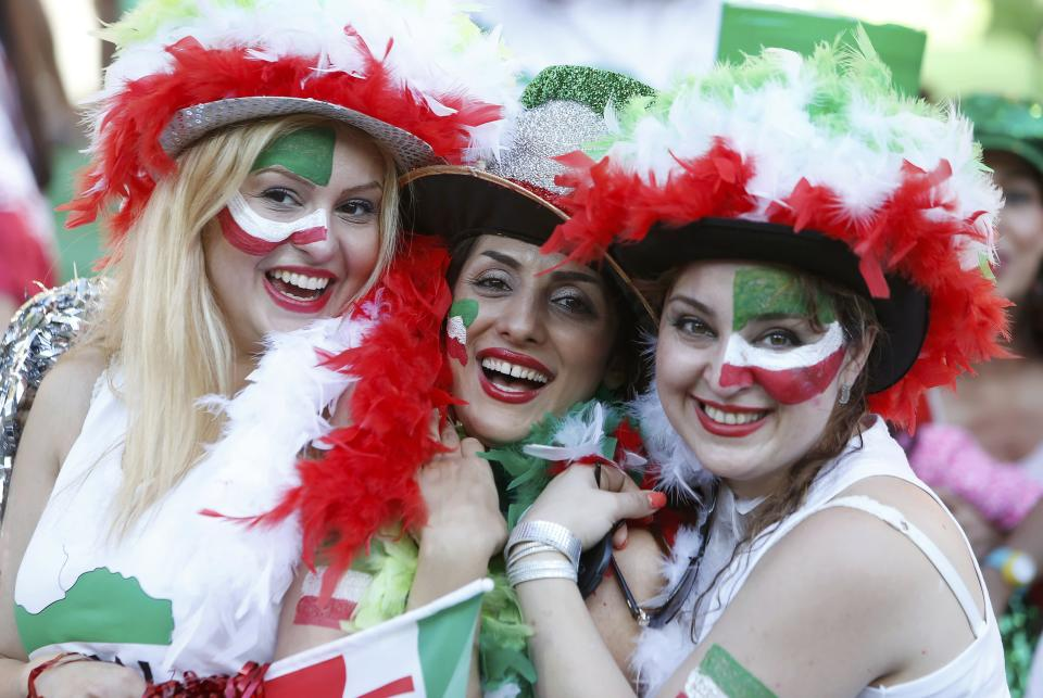 Iran supporters wearing colourful team colours smile before the Asian Cup Group C soccer match betweeen Iran and Bahrain at the Rectangular stadium in Melbourne January 11, 2015. REUTERS/Brandon Malone (AUSTRALIA - Tags: SOCCER SPORT)