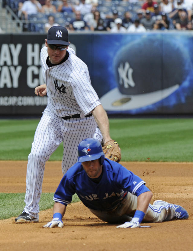 New York Yankees third baseman Chase Headley, left, tags out Toronto Blue Jays' Steve Tolleson on a fielders's choice during the fourth inning of a baseball game Saturday, July 26, 2014, at Yankee Stadium in New York. (AP Photo/Bill Kostroun)