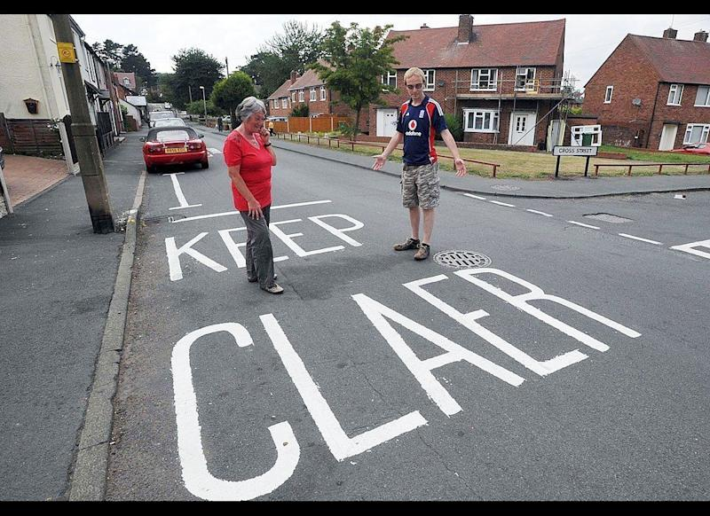 """An incorrectly spelled """"Keep Clear"""" road marking is pictured in Kingswinford, on August 3, 2011 in West Midlands, England."""