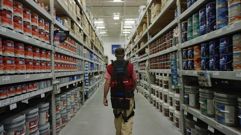 A Lowe's employee wears an exo-suit as part of a pilot program in Virginia. (Quartz)